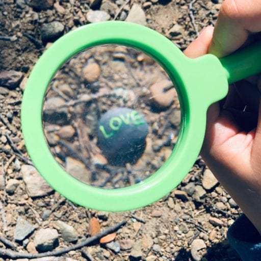 """Kid's magnifying glass focuses on a """"love"""" rock"""