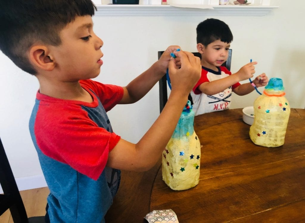 Bug Finishing the handle on the Lantern Camping Craft for Kids