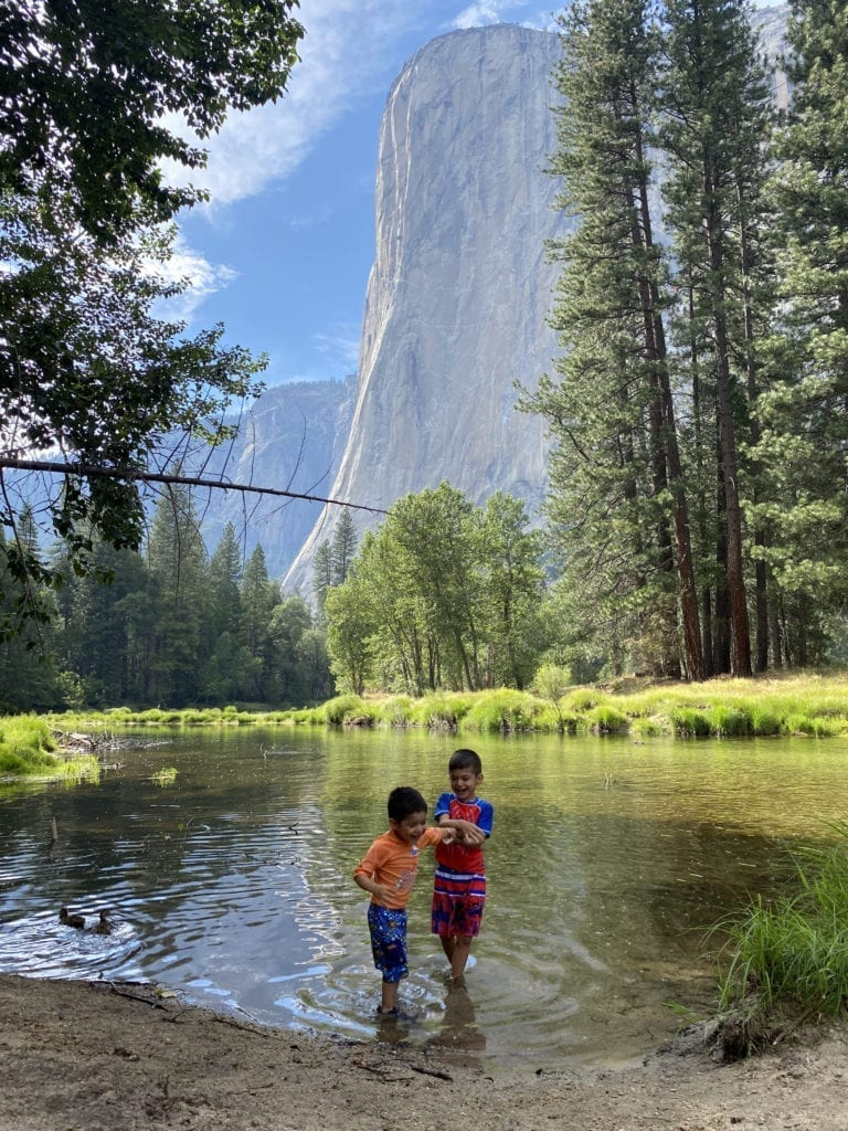 Kids splashing in the Merced, oblivious to El Cap behind them. Yosemite with kids