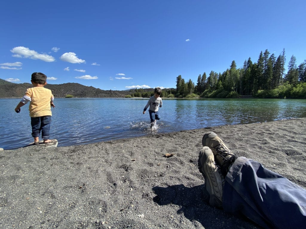 The kids splash in Butte Lake after hiking Cinder Cone: Lassen Family Road Trip