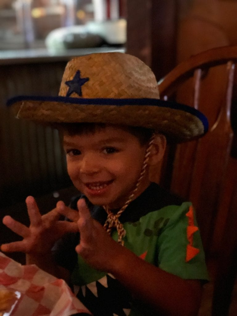 JJ getting into the cowboy spirit at the Big Texan Steakhouse in Amarillo