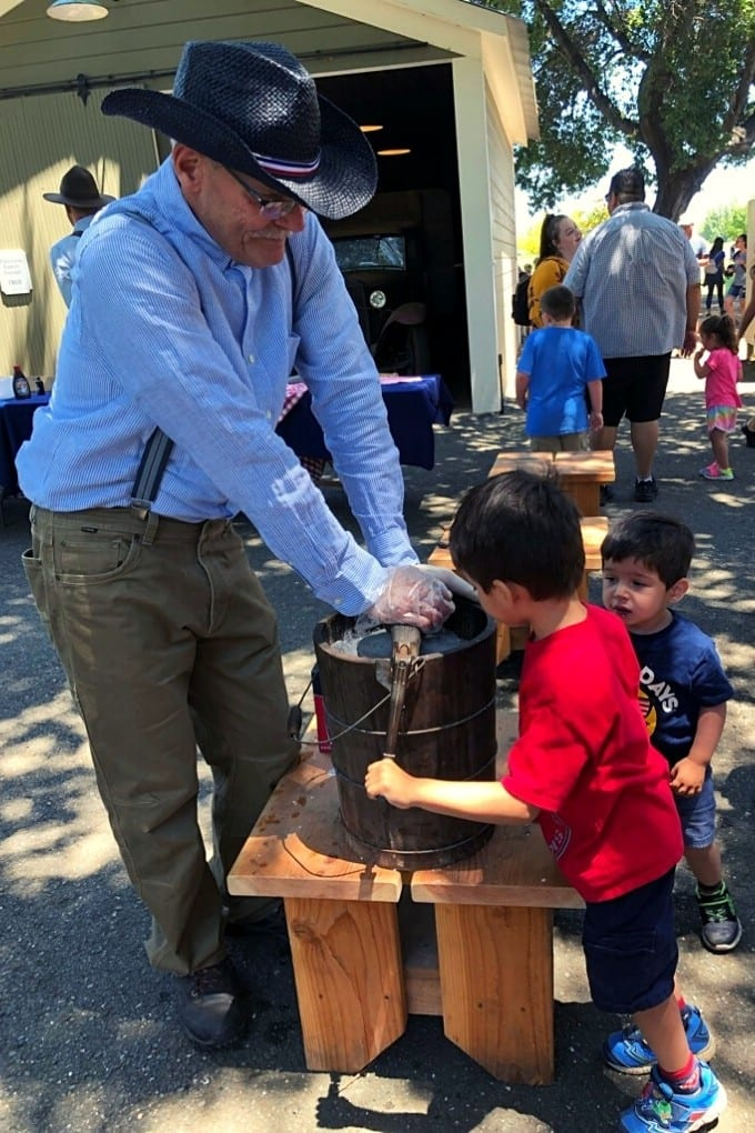 A friendly docent teaches the boys how to make ice cream the old fashioned way at Ardenwood Historic Farm.