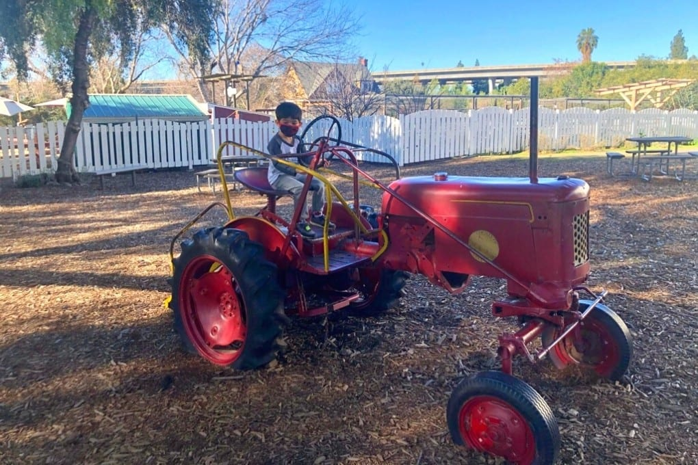 Playing on the tractor at Emma Prusch Farm Park