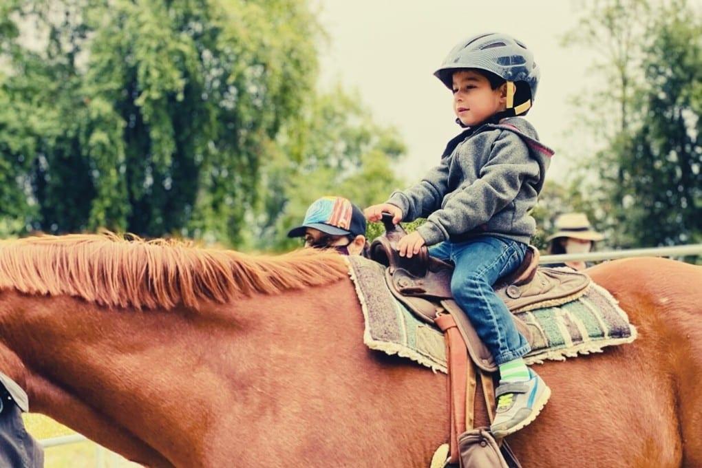 Bug's first horseback ride at Los Gatos Farms