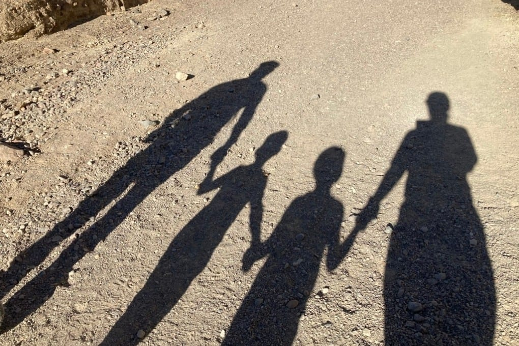 Our family's shadow on the trail in Golden Canyon, Death Valley National Park