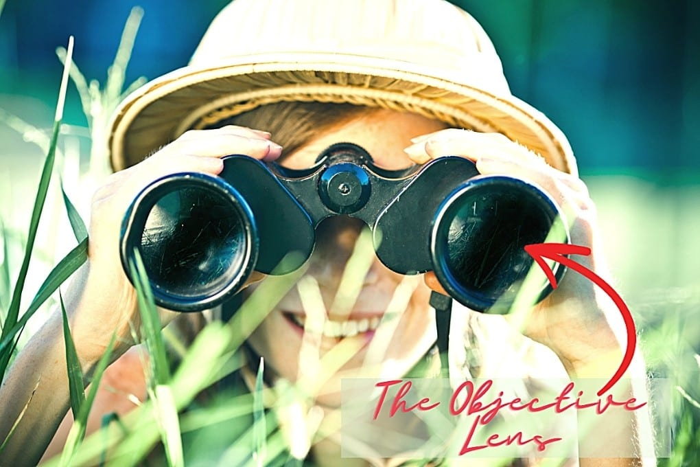 Image pointing to the wide outer lens of binoculars, known as the Objective Lens