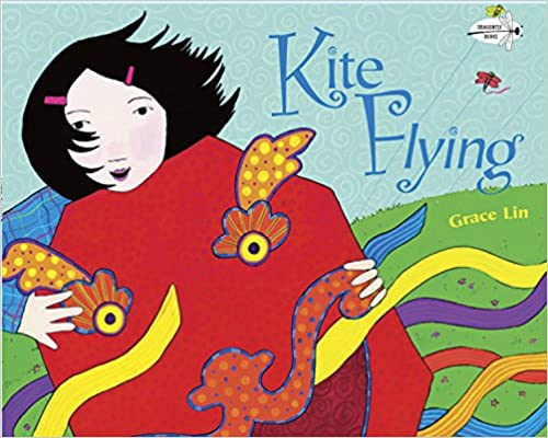 Kite Flying Book Cover - a girl holding a colorful kite, with a red dragon face