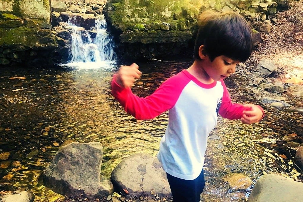JJ playing at the Old Dam on the Uvas Waterfall Loop