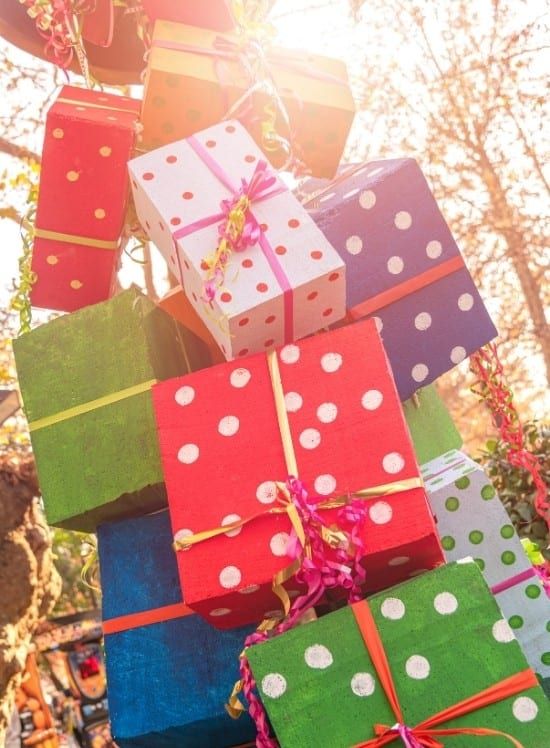 Image of Gifts Spilling out from a container in the woods