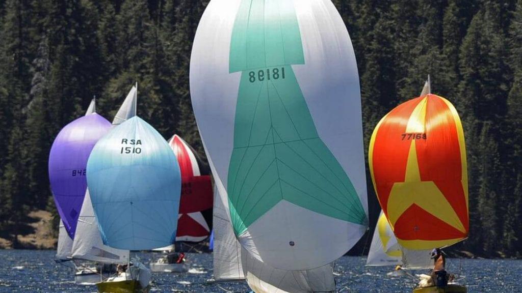 Sailboats with full sails at Huntington Lake's High Sierra Regatta