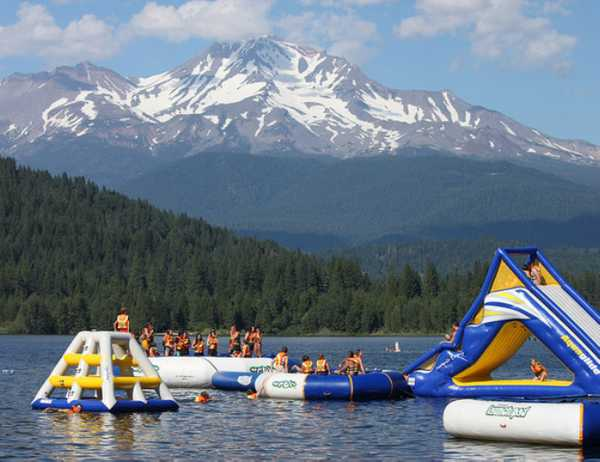 Lake Siskiyou Camp Resort's inflatable playground off the camp beach