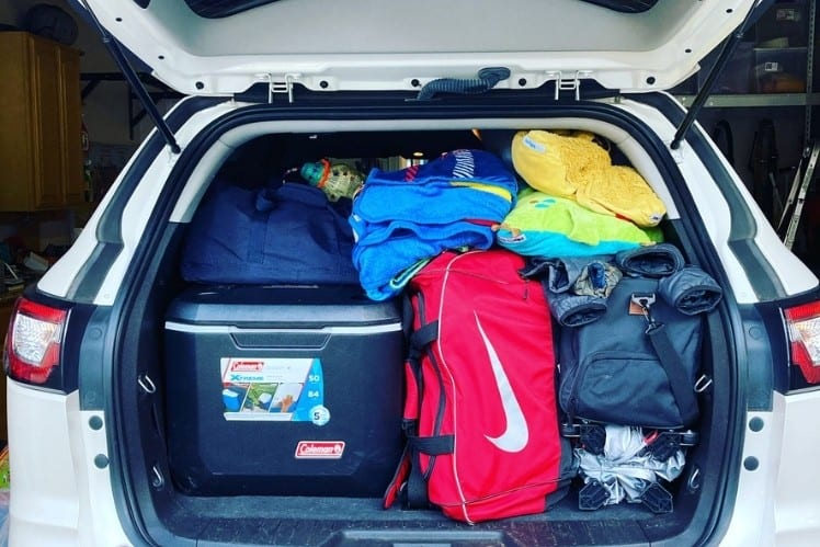 Our top family road trip essential is a good packing list. The back of our SUV packed with everything we need for a camping road trip.