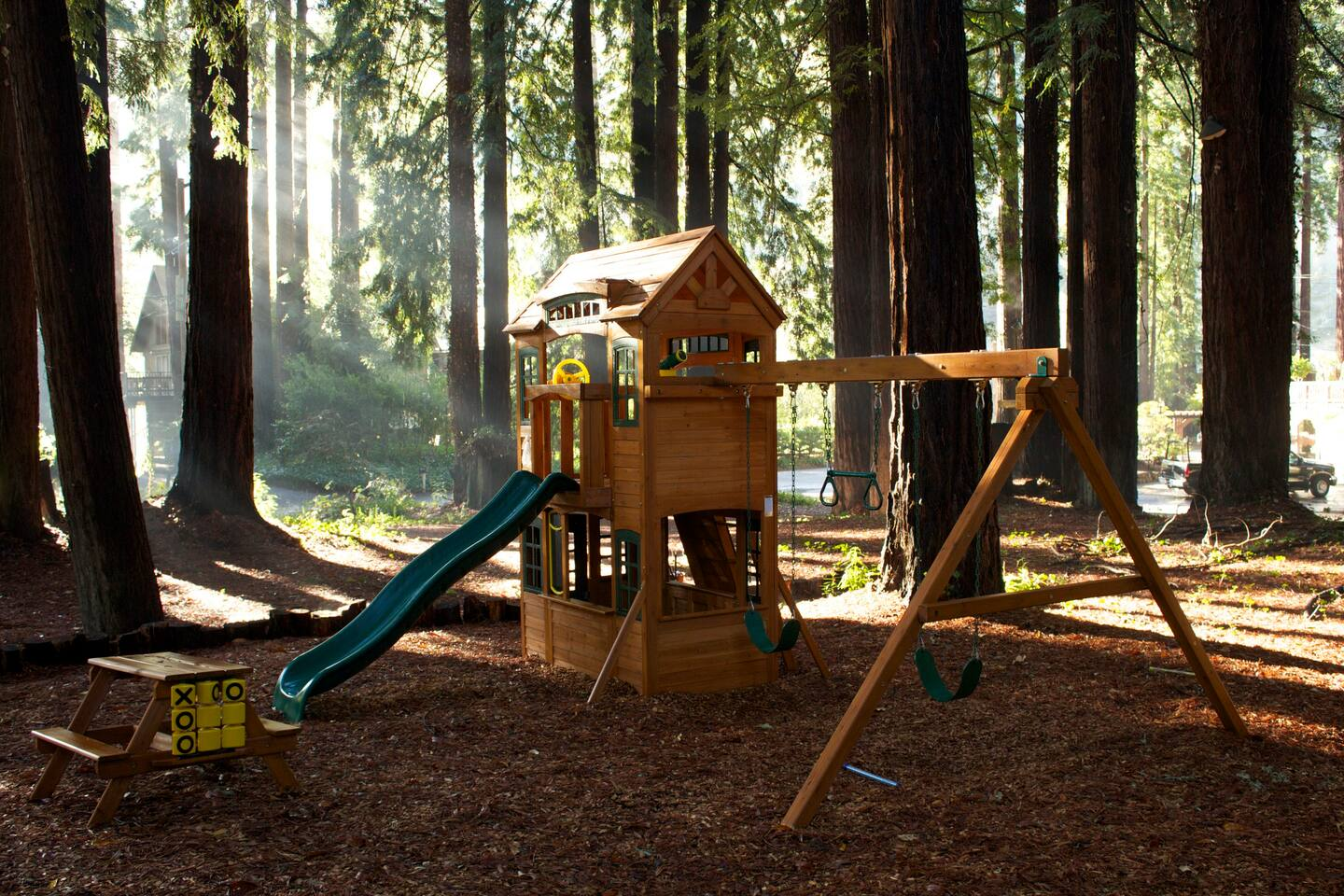 Casa Sophia is a family friendly vacation rental in Monte Rio, complete with playset in a large tree grove
