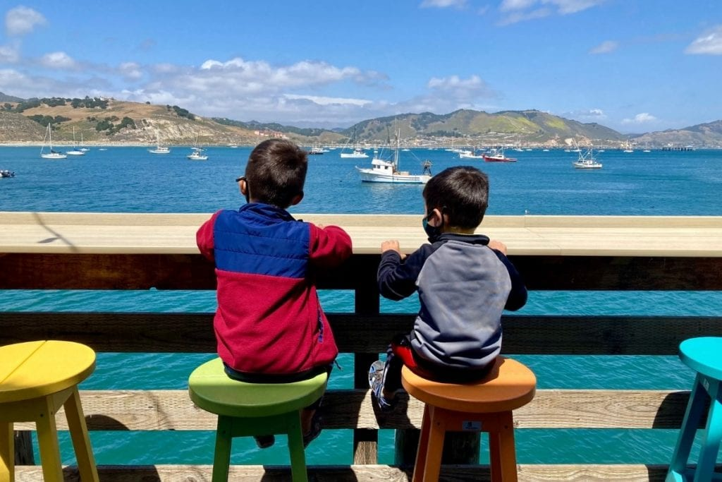 The boys looking out over Avila Harbor from Mersea's Restaurant