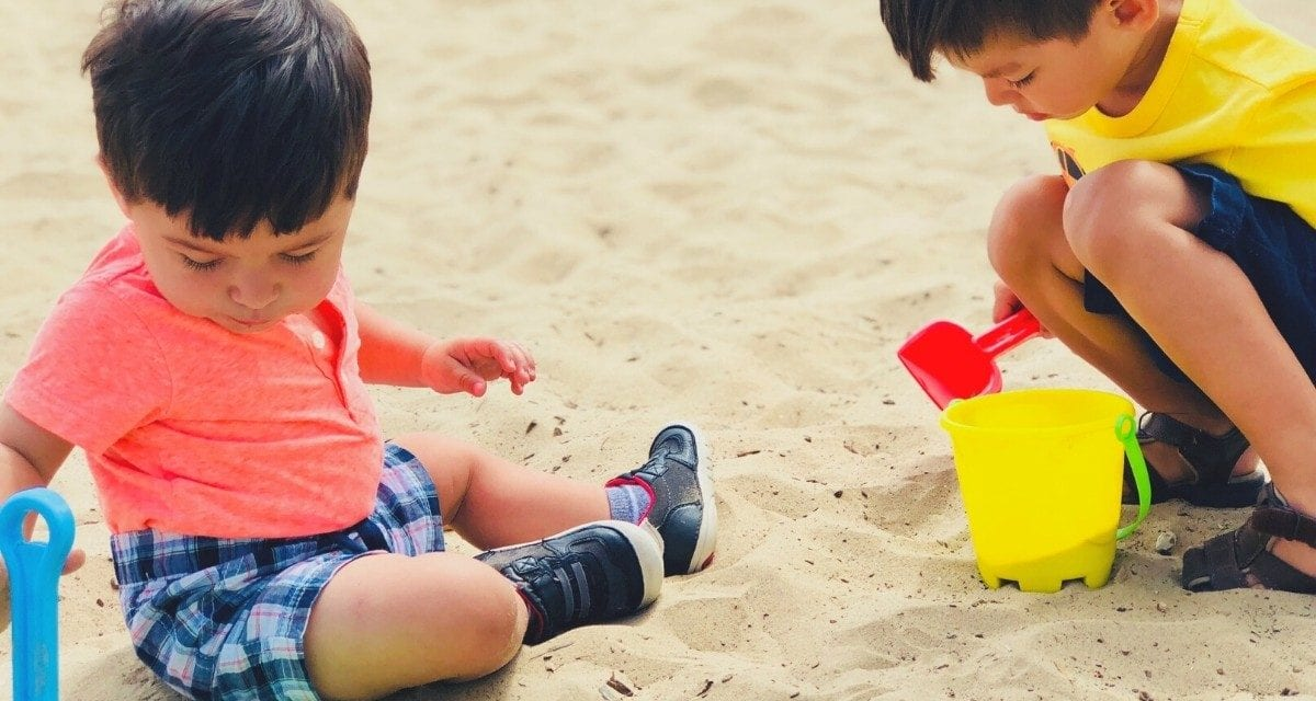The boys playing in the sand on their first visit to a California beach (West Beach, Santa Barbara)