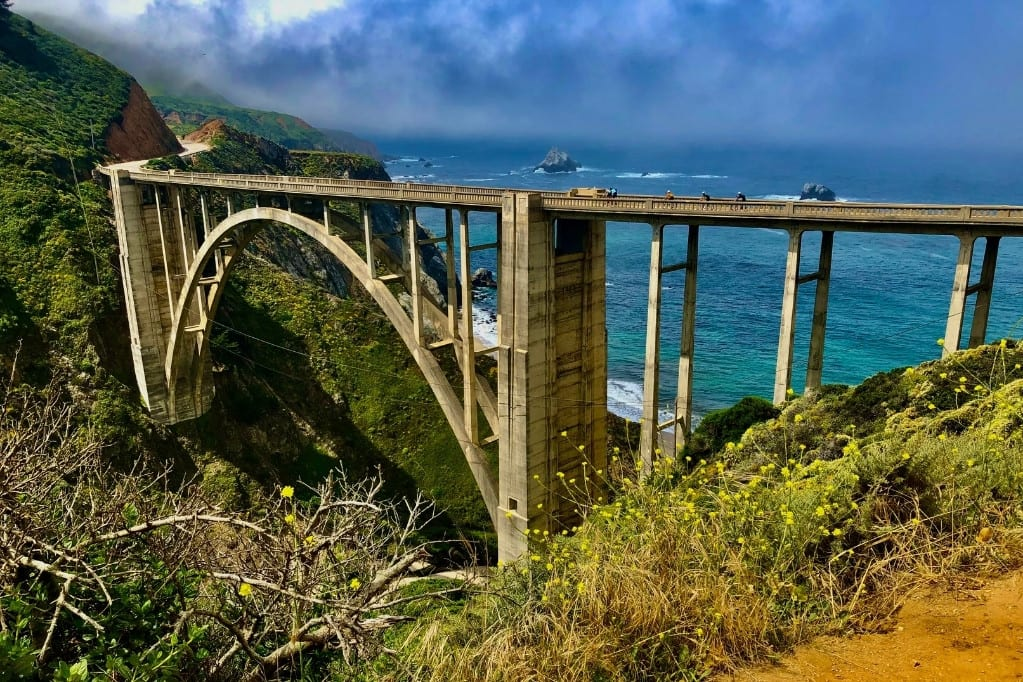 View of Bixby Bridge from the parking pull out on the northeastern edge. The bridge has become a symbol of Big Sur, and a photo here is a must for many on a highway 1 road trip.