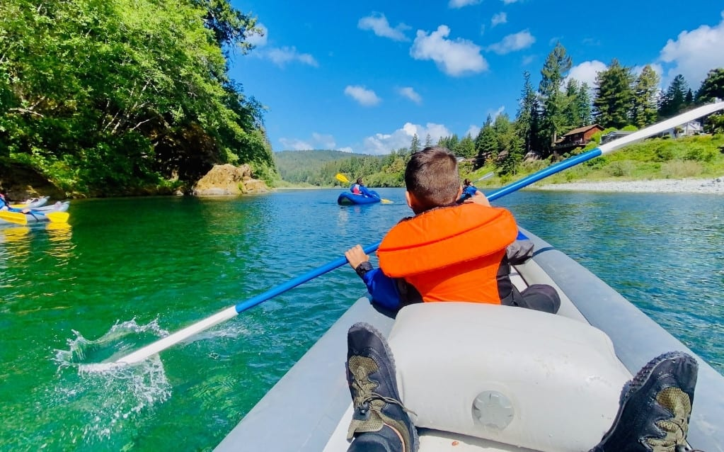 JJ learning to kayak on Smith River