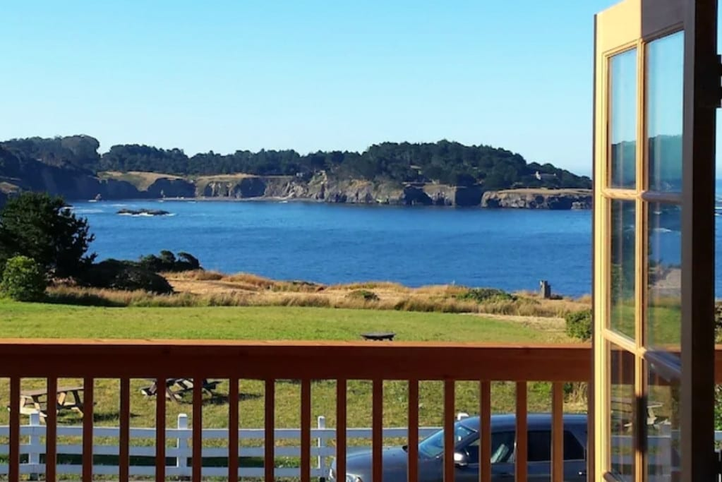 View of the ocean and Mendocno Headlands State Park from the living room of this centrally located vacation rental.