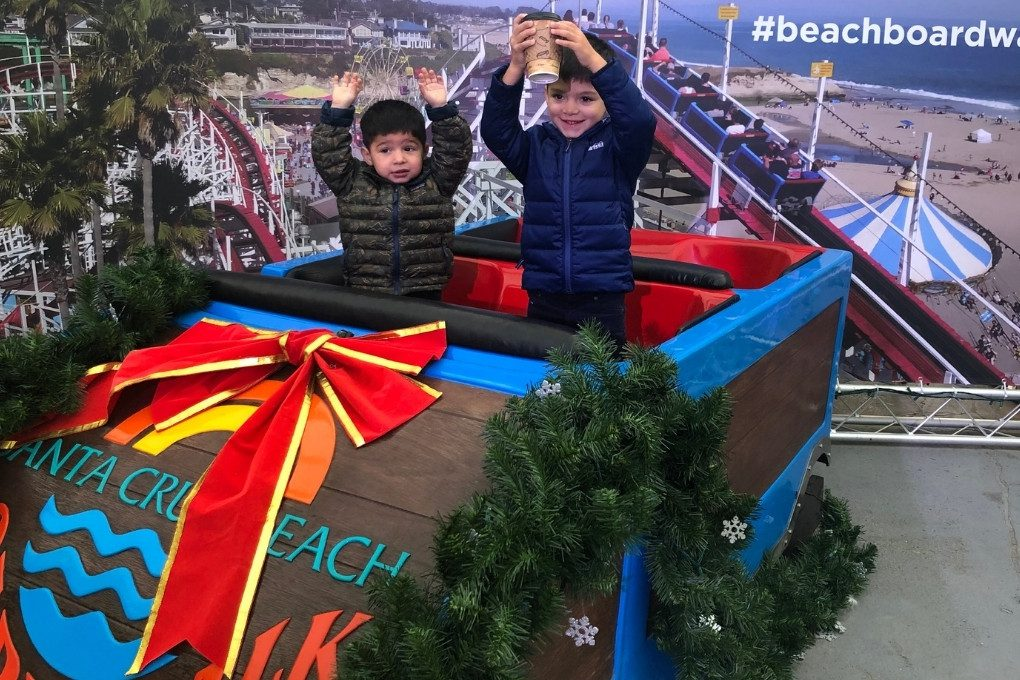 The Santa Cruz Beach Boardwalk is all decked out in December. Here the boys pose on a decorated car from the famous Giant Dipper Roller Coaster Ride.