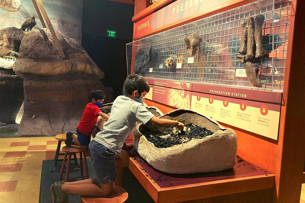 Playing in the exhibits at the Field House Museum of Natural History in Vernal, Utah