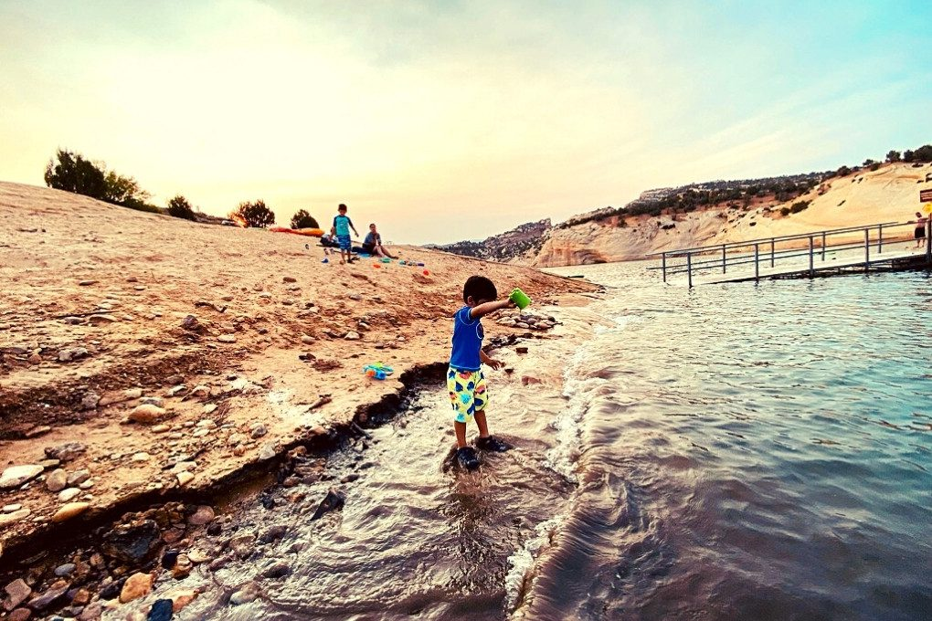 Playing on the shores of Red Fleet Reservoir